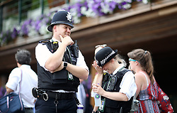 Police presence on day three of the Wimbledon Championships at the All England Lawn Tennis and Croquet Club, Wimbledon.