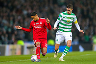 Max Lowe (#29) of Aberdeen on the ball under pressue from Mikael Lustig (#23) of Celtic during the Betfred Cup Final between Celtic and Aberdeen at Celtic Park, Glasgow, Scotland on 2 December 2018.