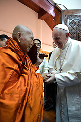 Pope Francis greets Bhaddanta Kumarabhivasma, chairman of the supreme council of Buddhist monks, during a meeting with monks of the council at the Kaba Aye Pagoda in Yangon, Myanmar on November 29, 2017. Pope Francis' visit in Myanmar and Bangladesh runs from 27 November to 02 December 2017. Photo by ABACAPRESS.COM