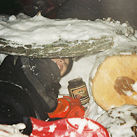 1. When was this photo taken?<br /> <br /> 2004<br /> <br /> 2. Where was this photo taken?<br /> <br /> Saint Paul, Minnesota<br /> <br /> 3. Who took this photo?<br /> <br /> Tammy Gilbert Mancha<br /> <br /> 4. What are we looking at here?<br /> <br /> A proud boy (my son) who built a fort in the snow. He made sure to bring a candle, blanket and book! All the essentials for a snow fort.<br /> <br /> 5. How does this old photo make you feel? <br /> <br /> Nostalgic and thinking of my son as a little boy. I miss those days- he is now going on 22 years old. It really is a good depictions of childhood in Minnesota. We play in the snow! It also made me think of my own childhood and all the fun we had in the winter enjoying the snow and sweet feeling of frozen toes on a hot heater!<br /> <br /> 6. Is this what you expected to see?<br /> <br /> I thought I would see pictures of my son but, I didn't know what he would be doing.<br /> <br /> 7. Does this photo bring back any memories?<br /> <br /> Yes, all of the fun times we had when he was younger and it made me think of my own childhood too.<br /> <br /> 8. How do you think others will respond to this photo?<br /> <br /> What is that! I had to look a little closer at the picture, at first it's not obvious what your looking at.