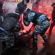 Members of Russia's OMON (Special Force) arrest protesters, who demonstrated in Moscow against what they said were rigged presidential elections..Russia went to the poll the day before to vote for Vladimir Putin's chosen successor, Dmitry Medvedev. .The protesters are part of a loose coalition of opposition members led by the former world chess champion Garry Kasparov and writer Eduard Limonov.