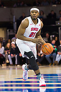 DALLAS, TX - JANUARY 04:  Ben Emelogu II #21 of the SMU Mustangs brings the ball up court against the Temple Owls during a basketball game on January 4, 2017 at Moody Coliseum in Dallas, Texas.  (Photo by Cooper Neill/Getty Images) *** Local Caption *** Ben Emelogu II