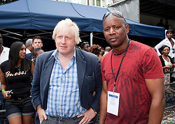 © Licensed to London News Pictures. 29/08/2011. London, UK. Boris Johnson with Notting Hill Carinval Director Ancil Barclay. London Mayor Boris Johnson visits the Notting Hill Carnival on Bank Holiday Monday and is greeted enthusiastically by Londoners and Carnivalists alike. Photo credit: Bettina Strenske/LNP