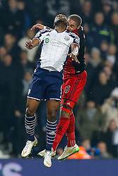 Brown Ideye of West Brom and Ashley Williams of Swansea City clash heads - Photo mandatory by-line: Rogan Thomson/JMP - 07966 386802 - 11/02/2015 - SPORT - FOOTBALL - West Bromwich, England - The Hawthorns - West Bromwich Albion v Swansea City - Barclays Premier League.