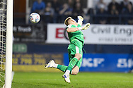 AFC Wimbledon goalkeeper Aaron Ramsdale dives but misses the shot on goal as Luton Town score their second goal of the half during the EFL Sky Bet League 1 match between Luton Town and AFC Wimbledon at Kenilworth Road, Luton, England on 23 April 2019.