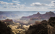 Clouds cast shadows in late afternoon light over the Grand Canyon. This view is looking west from Cape Royal on the north rim.