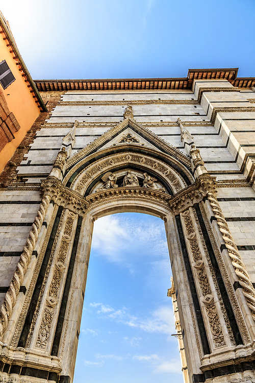 A gate to Piazza del Duomo in Siena, Italy.