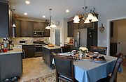 """The kitchen has an L-shaped walk-in pantry behind a frosted glass door (left of center in background) that has the word """"Pantry"""" on it. Sheridan and Rikki Glen are At Home in their Tanglewood subdivision home in Caseyville, IL on Wednesday January 16, 2019. <br /> Photo by Tim Vizer"""