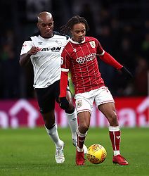 Derby County's Andre Wisdom (left) and Bristol City's Bobby Reid (right) battle for the ball