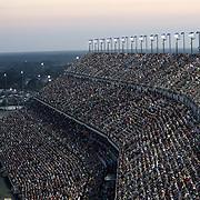 Spectators fill the stands during the 60th Annual NASCAR Daytona 500 auto race at Daytona International Speedway on Sunday, February 18, 2018 in Daytona Beach, Florida.  (Alex Menendez via AP)