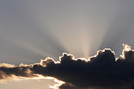Middletown, N.Y. - Rays of sunlight shoot from behind a could on a spring evening on June 15, 2006. ©Tom Bushey