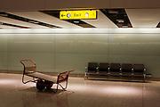 International baggage reclaim hall seating and Skycap luggage barrow at Heathrow's Terminal 5. .