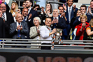 Forest Green Rovers manager, Mark Cooper with the play off final trophy during the Vanarama National League Play Off Final match between Tranmere Rovers and Forest Green Rovers at Wembley Stadium, London, England on 14 May 2017. Photo by Adam Rivers.