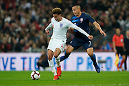 Dele Alli of England under pressure from Bobby Wood of USA during the International Friendly match between England and USA at Wembley Stadium, London, England on 15 November 2018.