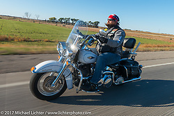 Russell Crosby of the Old Cronies in Sultan Washington riding his Heritage Softail in the USS South Dakota submarine flag relay across South Dakota. Groton, SD. USA. Sunday October 8, 2017. Photography ©2017 Michael Lichter.