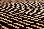 Adobe bricks, handmade from clay, straw and horse hair, dry arranged in neat rows in the indigenous Kumiai village of San Antonio Necua, Baja California Norte, Mexico.