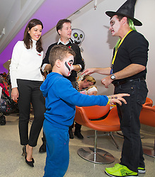 © London News Pictures. 31/10/2013 . London, UK.  Deputy Prime Minister NICK CLEGG and his wife MIRIAM GONZALEZ DURANTEZ talk to RIAN CAREY (front, aged 5) while meeting children, parents and volunteers at the Great Ormond Street Hospital annual Halloween party.  Photo credit : Ben Cawthra/LNP