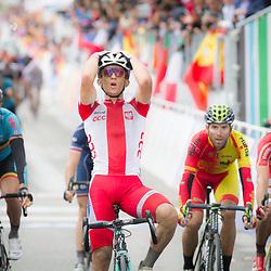 28-09-2014: Wielrennen: WK weg Elite mannen: Ponferrada <br /> WIELRENNEN PONFERRADA SPAIN ROAD RACE ELITE MEN<br /> Michael Kwiatkowski  is the 2014 World Champion 2md Simon Gerrans and Alejandro Valverde 3th