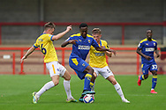 AFC Wimbledon attacker Zach Robinson (14) battles with Brighton and Hove Albion midfielder Marc Leonard (56) during the EFL Trophy Southern Group G match between AFC Wimbledon and Brighton and Hove Albion U21 at The People's Pension Stadium, Crawley, England on 22 September 2020.