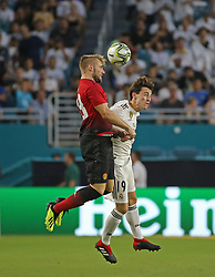 Manchester United defender Luke Shaw, left, jumps for the ball with Real Madrid defender Alvaro Odriozola (19) during the first half during International Champions Cup action at Hard Rock Stadium in Miami Gardens, FL, USA on Tuesday, July 31, 2018. Manchester United won, 2-1. Photo by David Santiago/Miami Herald/TNS/ABACAPRESS.COM