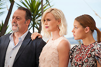 Jean Reno,  Charlize Theron and Adèle Exarchopoulos, at the The Last Face film photo call at the 69th Cannes Film Festival Friday 20th May 2016, Cannes, France. Photography: Doreen Kennedy