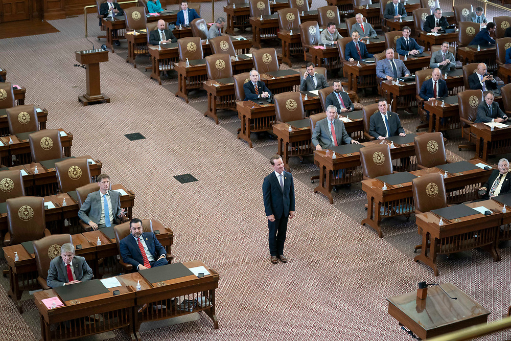 House Speaker Dade Phelan poses for a picture in the middle of the chamber as Republican Texas House members pose for a panorama on the second day of failing to get a quorum at a special session. Most Democratic members left the state protesting of restrictive voting measures proposed byTexas Gov. Greg Abbott.