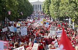 May 1, 2019 - Raleigh, NC, USA - Thousands of teachers, other school employees and their supporters march up Fayetteville Street through downtown Raleigh during a ''Day of Action'' organized by the N.C. Association of Educators on Wednesday, May 1, 2019. (Credit Image: © TNS via ZUMA Wire)
