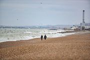People walk along the coastline of Brighton and Hove on Monday, May 3, 2021 - as heavy rain and strong gusts caused damage and disruption for many parts of England. (Photo/ Vudi Xhymshiti)