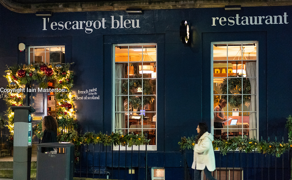 Edinburgh, Scotland, UK. 14 December 2020. City of Edinburgh controversially remains in Level 3 of lockdown meaning bars and restaurants must close at 6pm and not sell alcohol. Most bars have chosen to remain closed, Tuesday will see Scottish Government announce if the city will relax lockdown to level 2 or remain at level 3. Pic; L'escargot bleu restaurant on Broughton Street. Iain Masterton/Alamy Live News