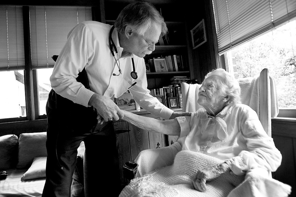"""Dr. Dale Hamrick greets Bea Geiger and prepares to perform a routine checkup on the 97-year-old inside her Columbia home. """"You know if you keep growing I'm going to have to put a new roof on this house,"""" she jokes."""