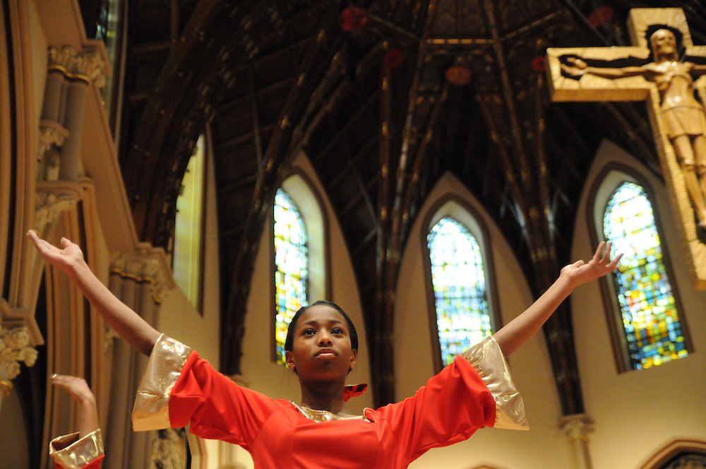 """Chicago Catholic Schools liturgical dancer Zoie Horton, 12, celebrate the 33rd Annual African American Heritage Month Eucharistic Celebration at Holy Name Cathedral. This year's mass celebrates the the Nguzo Saba principle of Kuumba, or """"creativity"""" at Holy Name Cathedral."""