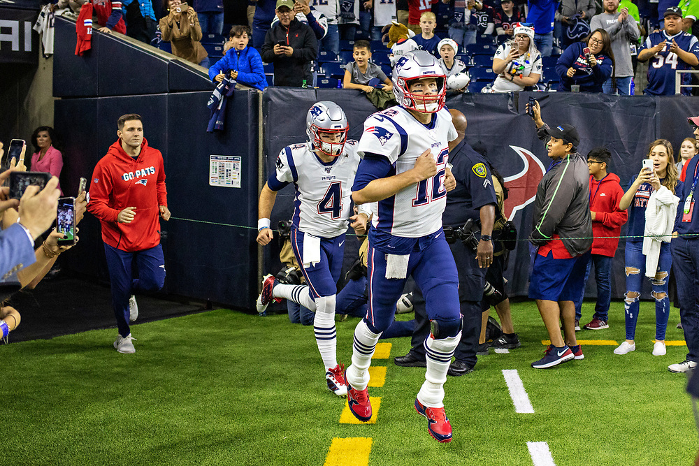 HOUSTON, TX - DECEMBER 1:  Tom Brady #12 of the New England Patriots runs onto the field before a game against the Houston Texans at NRG Stadium on December 1, 2019 in Houston, Texas.   (Photo by Wesley Hitt/Getty Images) *** Local Caption *** Tom Brady