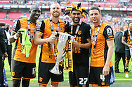 David Meyler of Hull City (c) poses with the Sky Bet Championship Playoff Trophy with Mohamed Diame of Hull City, Ahmed Elmohamady of Hull City, Alex Bruce of Hull City. Skybet football league Championship play off final match, Hull city v Sheffield Wednesday at Wembley Stadium in London on Saturday 28th May 2016.<br /> pic by John Patrick Fletcher, Andrew Orchard sports photography.