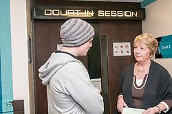 Defendant outside court speaking to the duty usher