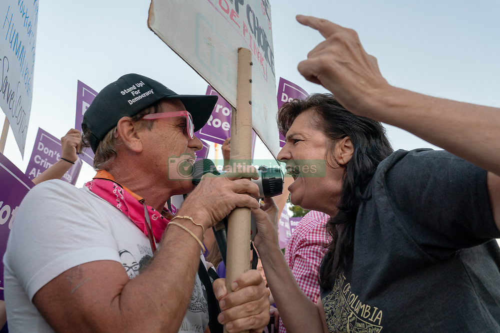 July 9, 2018 - Washington, District of Columbia, District of Columbia - Pro-choice and anti-abortion protesters demonstrate in front of the U.S. Supreme Court prior to President Trump nominating federal judge Brett Kavanaugh to Supreme Court to succeed retiring Justice Anthony Kennedy. (Credit Image: © Ken Cedeno via ZUMA Wire)
