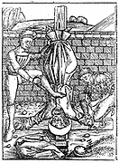Martyrdom of St Peter who is said to have been crucified at Rome with head, not feet, nearest the ground. From Hartmann Schedel 'Liber chronicarum mundi' (Nuremberg Chronicle) Nuremberg, 1495. Woodcut.