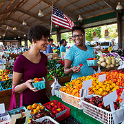 Simone Jones, left, talks with Nena Abai as they shop for peppers at the Moore's Produce booth at the North Carolina State Farmers Market in Raleigh. Nathan Lambrecht/Journal Communications