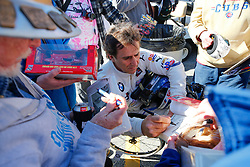 January 25, 2019 - Daytona, FL, U.S. - DAYTONA, FL - JANUARY 25: Alex Zanardi, driver of the #24 BMW Team RLL BMW M8 GTE signs autographs for fans following practice for the Rolex 24 at Daytona on January 25, 2019 at Daytona International Speedway in Daytona Beach, Fl. (Photo by David Rosenblum/Icon Sportswire) (Credit Image: © David Rosenblum/Icon SMI via ZUMA Press)