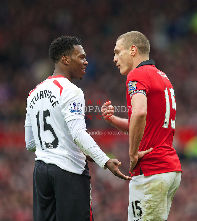 MANCHESTER, ENGLAND - Sunday, March 16, 2014: Manchester United's captain Nemanja Vidic argues with Liverpool's Daniel Sturridge after being sent off during the Premiership match at Old Trafford. (Pic by David Rawcliffe/Propaganda)