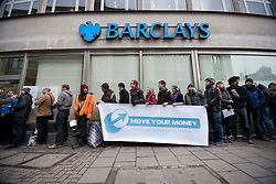 © licensed to London News Pictures. London, UK 10/02/2012. Members of Barclays Bank demonstrate outside a branch of Barclays Banks in central London on February 10th, 2012, in support of the 'Move Your Money UK' campaign. Barclays today (10/02/2012) announces its annual results. Photo credit: Tolga Akmen/LNP