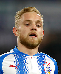 """Huddersfield Town's Alex Pritchard during the Premier League match at the John Smith's Stadium, Huddersfield. PRESS ASSOCIATION Photo. Picture date: Saturday January 13, 2018. See PA story SOCCER Huddersfield. Photo credit should read: Martin Rickett/PA Wire. RESTRICTIONS: EDITORIAL USE ONLY No use with unauthorised audio, video, data, fixture lists, club/league logos or """"live"""" services. Online in-match use limited to 75 images, no video emulation. No use in betting, games or single club/league/player publications"""