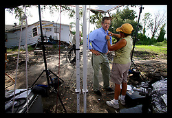 29 August 2006 - New Orleans - Louisiana. Lower 9th ward.  The one year anniversary of hurricane Katrina. Brian Williams, NBC news anchor of the 'Nightly News' is 'miked up' for his 5.00pm live slot from the flood ravaged area. (6.00pm east coast). Williams has been a staunch supporter of New Orleans and has been a great vocal critic of the slow pace of reform and has heavily criticised both federal and local government ineptitude. Many New Orleanians support Williams and his continued efforts to highlight the vast array of problems still facing the community and applaud him for his efforts to maintain the city as a 'newsworthy' story.