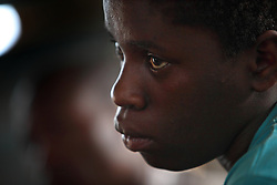 Phiona Mutesi, a 14-year-old chess prodigy, at the Agape Church inside Katwe, the largest slum in Kampala, Uganda, Dec. 8, 2010. Mutesi lives in the slums of Uganda and is just now learning to read. But her instincts have made her a player to watch in international chess. Mutesi, a naturally talented chess player is coached by Robert Katende of Sports Outreach Ministry. The chess club meets at the Agape Church.
