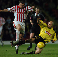 Fotball<br /> England 2004/2005<br /> Foto: SBI/Digitalsport<br /> NORWAY ONLY<br /> <br /> Date: 04/12/2004<br /> <br /> Watford v Stoke City <br /> Coca Cola Championship<br /> <br /> Dave Brammer of Stoke is tackled by Gavin Mahon of Watford.