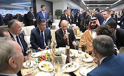 June 14, 2018 - Moscow, Russia - June 14, 2018. - Russia, Moscow. - Russian President Vladimir Putin during a break in the 2018 FIFA World Cup opening match between the national teams of Russia and Saudi Arabia. On the right in the background: Crown Prince of Saudi Arabia Mohammad bin Salman Al Saud. From left to right in the background: President of Moldova Igor Dodon and President of Kyrgyzstan Sooronbai Jeenbekov. (Credit Image: © Russian Look via ZUMA Wire)