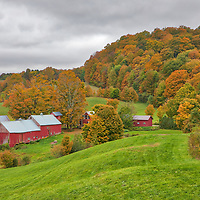 Rural Vermont photography of Jenne Farm in Reading, VT. Cloudy skies and a moderate fall foliage made for a great backdrop for this iconic farm, south of Woodstock.<br />