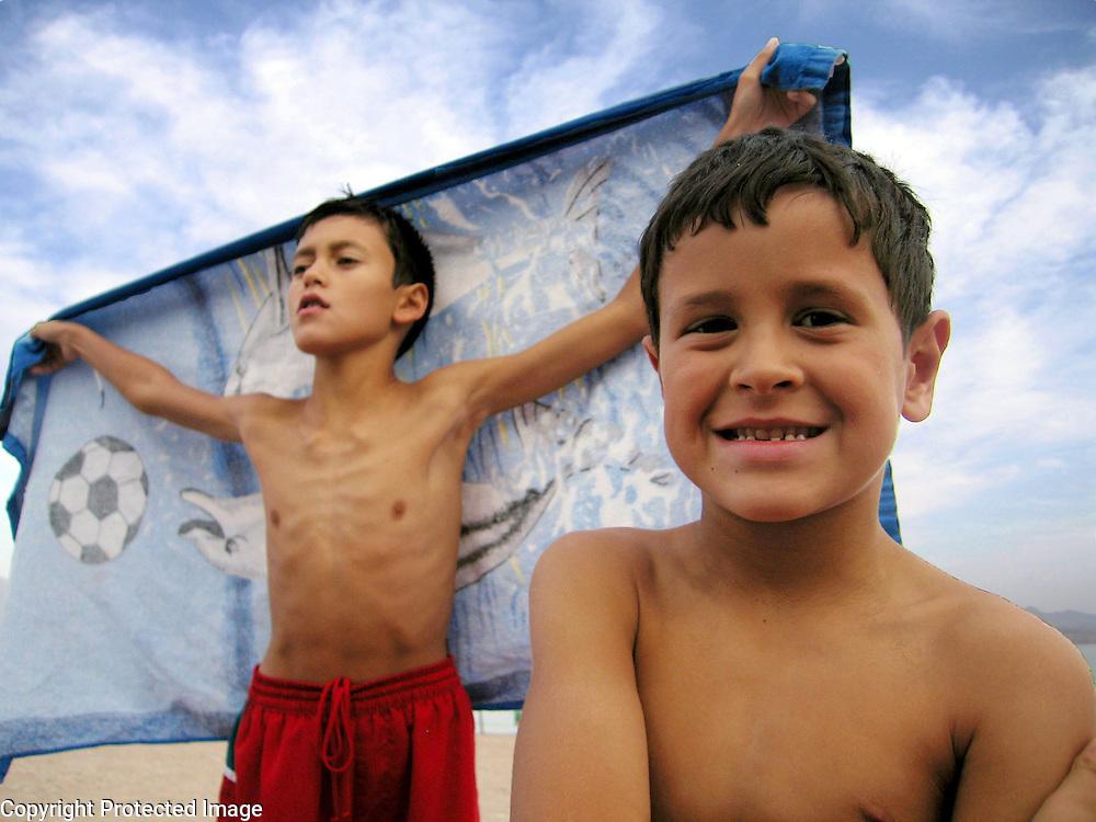 Brothers on beach, Eilat, Israel. Photography by Debbie Zimelman, Modiin, Israel