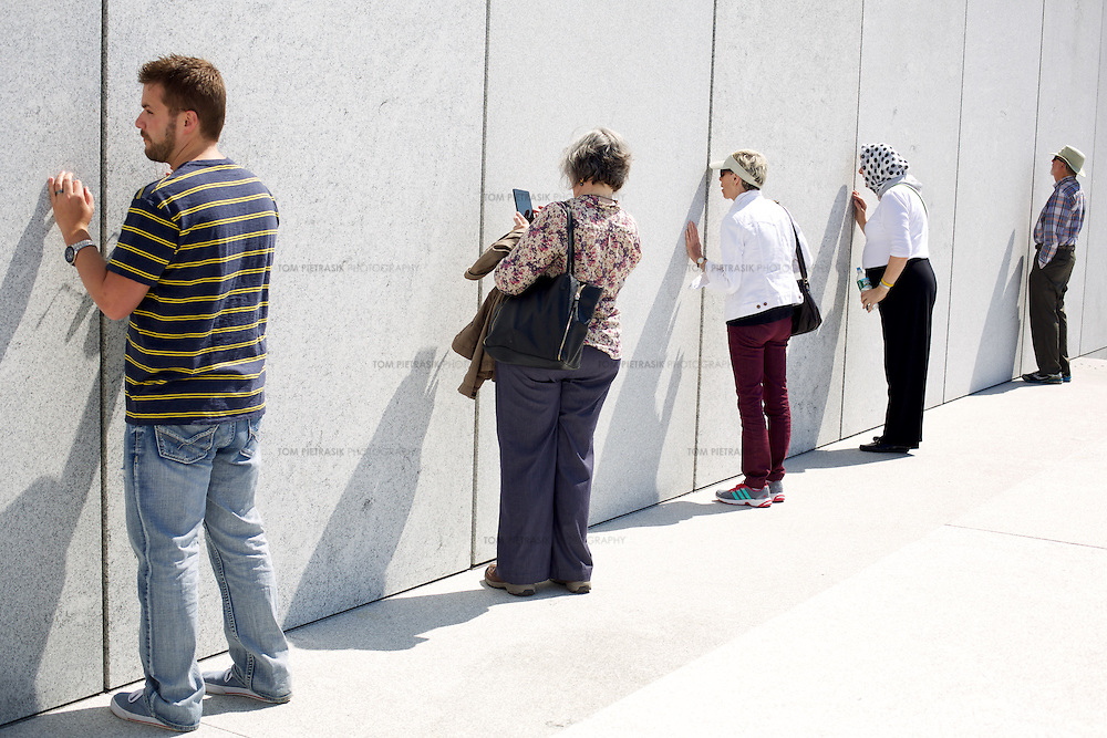 Tourists at FDR Four Freedoms Park on Roosevelt Island in New York City. The park was designed by Louis Kahn but completed almost 40 years after his death. <br /> <br /> Photo: Tom Pietrasik<br /> New York City, USA <br /> May 2nd 2015
