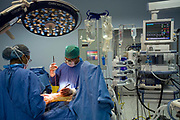 Doctors perform surgery in a state of the art operating theatre in the Medicity, Gurgaon, India<br /> <br /> The Medicity, Gurgaon is India's most technologically advanced multi disciplinary hospital. Founded by India's leading cardiac surgeon, Dr Naresh Trehan, it will when completed also contain a medical school and 1600 beds with over 48 operating theatres.