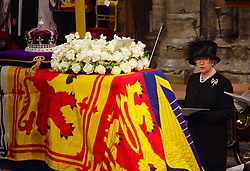 File photo dated 09/04/02 of Queen Elizabeth II standing near the coffin of Queen Elizabeth the Queen Mother during her funeral service at Westminster Abbey. The Queen mother's funeral was the last royal funeral to be extensively televised in the UK. Issue date: Friday April 16, 2021.